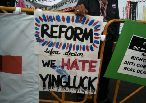 Anti-government protest signs seen at Asoke Intersection in Bangkok in early February. Photo by Kaewmala